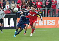 21 April 2012: Chicago Fire forward Dominic Oduro #8 and Toronto FC midfielder Torsten Frings #22 in action during a game between the Chicago Fire and Toronto FC at BMO Field in Toronto..The Chicago Fire won 3-2....