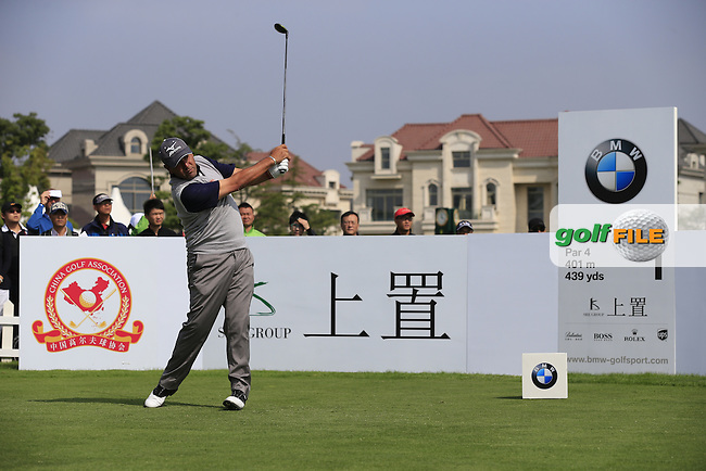 Ricardo Gonzalez (ARG) tees off the 1st tee to start his match during Saturday's Round 3 of the 2013 BMW Masters presented by SRE Group held at Lake Malaren Golf Club, Shanghai, China. 26th October 2013.<br /> Picture: Eoin Clarke/www.golffile.ie