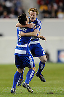 Dax McCarty (13) of FC Dallas celebrates scoring with Heath Pearce (4) during a Major League Soccer (MLS) match against the New York Red Bulls at Red Bull Arena in Harrison, NJ, on April 17, 2010.