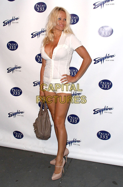 PAMELA ANDERSON.Sapphire Gentlemen's Club and Prime 333 Grand Opening Celebration held at Bar Artisanal, New York, NY, USA..April 27th, 2009.full length white top cleavage shirt hand on hip shorts brown bag mini micro pink mary janes shoes .CAP/ADM/PZ.©Paul Zimmerman/AdMedia/Capital Pictures.