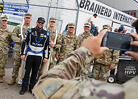 Aug 20, 2017; Brainerd, MN, USA; NHRA top fuel driver Shawn Langdon poses for a ohoto with US Army soldiers at the Lucas Oil Nationals at Brainerd International Raceway. Mandatory Credit: Mark J. Rebilas-USA TODAY Sports