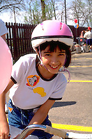 Girl age 7 smiling at Youth Express Bicycle Safety Rodeo.  St Paul  Minnesota USA