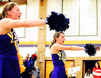 Madison East High School cheerleaders fire up the Purgolders fans on Thursday night, 2/19/09, at East High School in Madison, Wisconsin