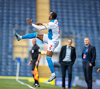 11th July 2020; Ewood Park, Blackburn, Lancashire, England; English Football League Championship Football, Blackburn Rovers versus West Bromwich Albion; Ryan Nyambe of Blackburn Rovers rises high with West Brom manager Slaven Bilić and Blackburn Rovers manager Tony Mowbray watching on in the background