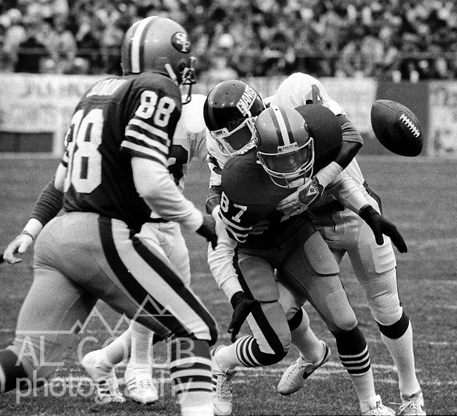 San Francisco 49ers vs. New York Giants at Candlestick Park Saturday, December 29, 1984..49ers beat Giants 21-10 Division Playoff.New York Giant defender knocks ball out of San Francisco 49ers Wide Receiver Dwight Clark (87) arms...