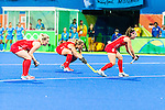 Laura Unsworth #4 of Great Britain, Crista Cullen #5 of Great Britain and Nicola White #28 of Great Britain set up for the short corner during India vs Great Britain in a Pool B game at the Rio 2016 Olympics at the Olympic Hockey Centre in Rio de Janeiro, Brazil.
