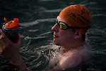 Simon Holiday of Great Britain swims the 35km from Hong Kong to Macau to raise funds for Ocean Recovery Alliance on May 24, 2014. A large pod of pink dolphins spurred on swimmer Simon Holiday to set a new Hong Kong to Macau record - completing the challenge yesterday in 10 hours, 20 minutes and 30 seconds. Photo by Anthony Kwan / Power Sport Images