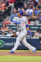 Chicago Cubs shortstop Addison Russell (22) swings at a pitch during a game against the Atlanta Braves on July 18, 2015 in Atlanta, Georgia. The Cubs defeated the Braves 4-0. (Tony Farlow/Four Seam Images)