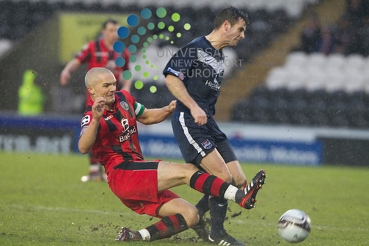Jim Goodwin takes Stuart Kettlewell of Ross during the St Mirren v Ross County William Hill Scottish Cup round Five..Picture: Maurice McDonald/Universal News And Sport (Scotland). 4 February 2012. www.unpixs.com.