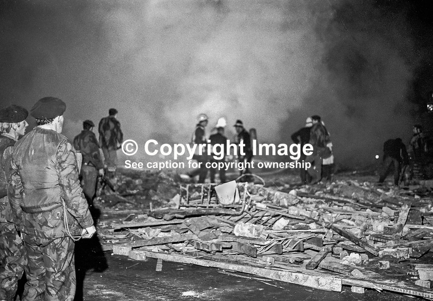 McGurk's Bar explosion in which 15 people died. Among those who died were the bar owner's wife and daughter. Thirteen were injured, one of whom subsequently died. Firemen in the smoking remains of the bar. NI Troubles. Ref: 19711204003..Copyright Image from Victor Patterson, 54 Dorchester Park, Belfast, UK, BT9 6RJ..Tel: +44 28 9066 1296.Mob: +44 7802 353836.Voicemail +44 20 8816 7153.Skype: victorpattersonbelfast.Email: victorpatterson@mac.com.Email: victorpatterson@ireland.com (back-up)..IMPORTANT: If you wish to use this image or any other of my images please go to www.victorpatterson.com and click on the Terms & Conditions. Then contact me by email or phone with the reference number(s) of the image(s) concerned.