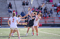 College Park, MD - April 27, 2019: John Hopkins Bluejays Ellie McNulty (55) gets hit by several Maryland Terrapins defenders during the game between John Hopkins and Maryland at  Capital One Field at Maryland Stadium in College Park, MD.  (Photo by Elliott Brown/Media Images International)
