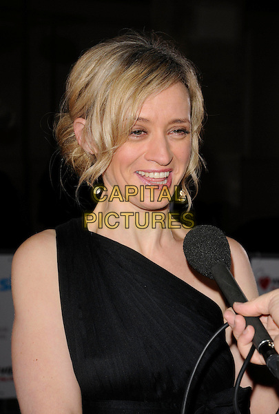 ANNE-MARIE DUFF.Attending the Variety Club Showbiz Awards 2008, held at Grosvenor House Hotel, London, England, .November 16th 2008..portrait headshot microphone being interviewed black one shoulder Anne Marie .CAP/CAN.©Can Nguyen/Capital Pictures