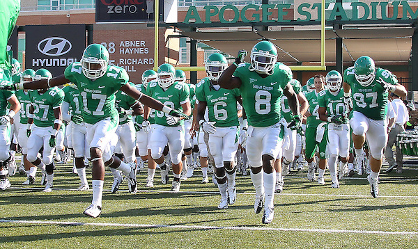 Denton, TX - NOVEMBER 3: North Texas Mean Green run onto the field for the start of the game against the Arkansas State Red Wolves at Apogee Stadium in Denton on November 3, 2012 in Denton, Texas. Photo by: Rick Yeatts