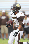 Palos Verdes, CA 11/04/11 - Hugo Yepez (West Torrance #1) in action during the West Torrance vs Peninsula varsity football game.