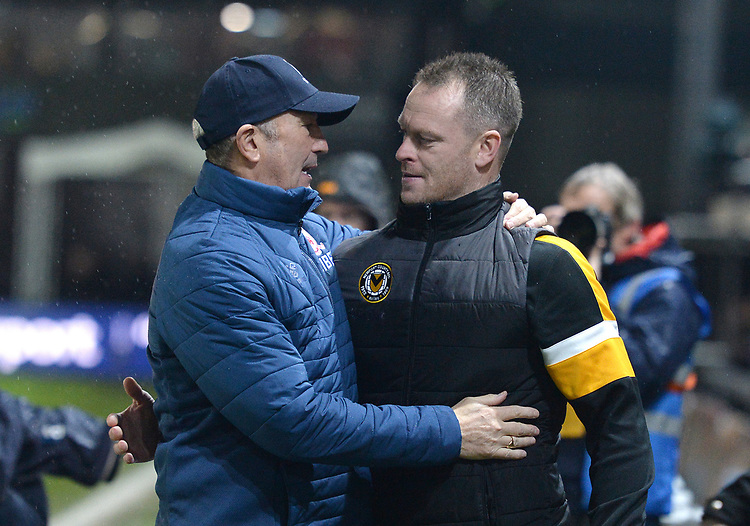 Newport County manager Michael Flynn and Middlesbrough manager Tony Pulis chat prior to kick off<br /> <br /> Photographer Ian Cook/CameraSport<br /> <br /> Emirates FA Cup Fourth Round Replay - Newport County v Middlesbrough - Tuesday 5th February 2019 - Rodney Parade - Newport<br />  <br /> World Copyright &copy; 2019 CameraSport. All rights reserved. 43 Linden Ave. Countesthorpe. Leicester. England. LE8 5PG - Tel: +44 (0) 116 277 4147 - admin@camerasport.com - www.camerasport.com