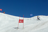 Switzerland. Valais. Crans Montana. Winter ski resort. Micaela Ruef in the ski competition (giant slalom) organised by the Swiss Ski School. Blue sky on a sunny day. © 2005 Didier Ruef