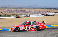 Jun. 21, 2009; Sonoma, CA, USA; NASCAR Sprint Cup Series driver Tony Stewart during the SaveMart 350 at Infineon Raceway. Mandatory Credit: Mark J. Rebilas-