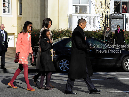United States President Barack Obama, first lady Michelle Obama (background) and daughters Malia (L) and Sasha walk from St. John's Church after Sunday services, back to the White House, December 11, 2011, Washington, DC.   .Credit: Mike Theiler / Pool via CNP