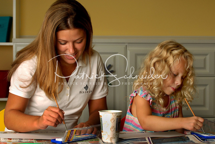 A young girl and teacher use watercolors at Berewick master-planned community in southwest Mecklenburg County, Charlotte, NC. The property is developed by Pappas Properties.
