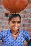 Portrait of Gujarat village girl balancing a water pot on her head, Gujarat, India --- Model Released