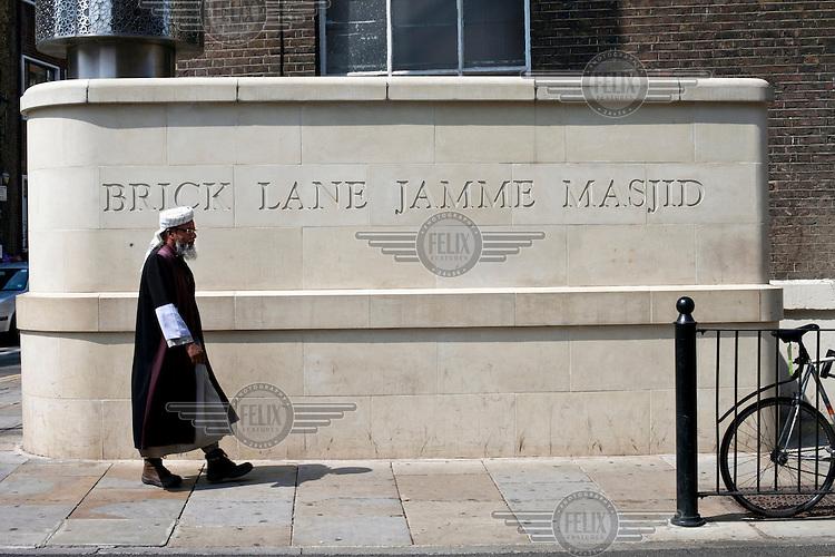 A man walks past the Brick Lane Jamme Masjid in Spitalfields, London.
