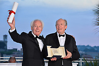 CANNES, FRANCE. May 25, 2019: Luc Dardenne & Jean-Pierre Dardenne at the Palme d'Or Awards photocall at the 72nd Festival de Cannes.<br /> Picture: Paul Smith / Featureflash