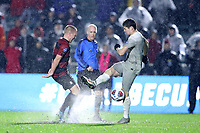 CARY, NC - DECEMBER 13: Derek Waldeck #4 of Stanford University and Sean Zawadzki #6 of Georgetown University struggle to control the ball in the wet conditions during a game between Stanford and Georgetown at Sahlen's Stadium at WakeMed Soccer Park on December 13, 2019 in Cary, North Carolina.