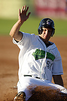 June 23, 2009:  Kyle Jensen of the Jamestown Jammers slides into third during a game at Russell Diethrick Park in Jamestown, NY.  The Jammers are the NY-Penn League Short-Season Class-A affiliate of the Florida Marlins.  Photo by:  Mike Janes/Four Seam Images