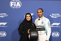 30th November 2019; Yas Marina Circuit, Abu Dhabi, United Arab Emirates; Formula 1 Abu Dhabi Grand Prix, qualifying day; Mercedes AMG Petronas Motorsport, Lewis Hamilton receives the Pirelli Pole Position Award from the Pirelli Representative, FIA Women in Motorsport Commission member and<br />