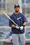 21 September 2012: Milwaukee Brewers outfielder Carlos Gomez awaits his turn in the batting cage prior to a game against the Washington Nationals at Nationals Park in Washington, DC. The Brewers rallied in the 9th inning to defeat the Nationals 4-2 in the first game of their 4-game series. Mandatory Credit: Ed Wolfstein Photo