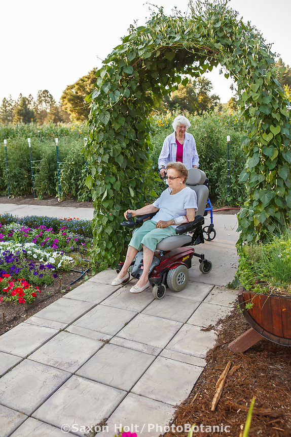 Elderly residents of Healdsburg Senior Living Center strolling and exercising in the Community garden