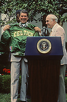 Washington DC., USA , June 13, 1984<br /> President Ronald Reagan meets with the Boston Celtics, the National Basketball Association World Champions, in the rose Garden. Coach Red Auerbach presents him with a team jacket. Credit: Mark Reinstein/MediaPunch