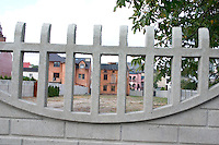 Several homes framed behind a curved fence. Rawa Mazowiecka Central Poland