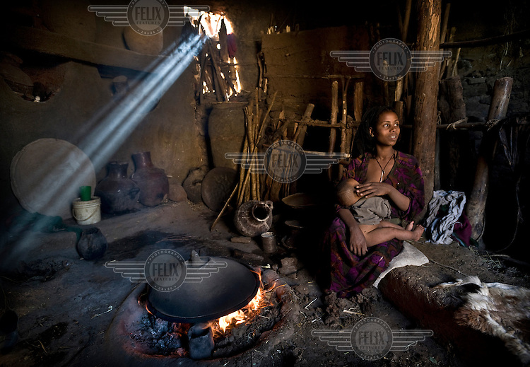 A mother breastfeeds her child in her home in a farming community north of Lalibela.