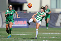 8 November 2015:  North Texas Defender Molly Grisham (6) attempts to control the ball as Marshall Midfielder Mack Moore (10) approaches in the first half as the Marshall University Thundering Herd faced the University of North Texas Mean Green in the Conference USA championship game at University Park Stadium in Miami, Florida.