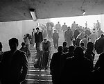 Istanbul - locals descend staircase to tunnel in order to cross a major street in Istanbul, Turkey