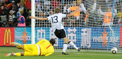 Germany's Thomas Mueller scores the 4-1 against England's goalkeeper David James during the 2010 FIFA World Cup Round of Sixteen match between Germany and England at the Free State Stadium in Bloemfontein, South Africa 27 June 2010.