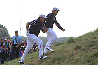 Phil Mickelson and Bryson DeChambeau (Team USA) heading to the 7th tee during the Friday Foursomes at the Ryder Cup, Le Golf National, Ile-de-France, France. 28/09/2018.<br /> Picture Thos Caffrey / Golffile.ie<br /> <br /> All photo usage must carry mandatory copyright credit (© Golffile | Thos Caffrey)