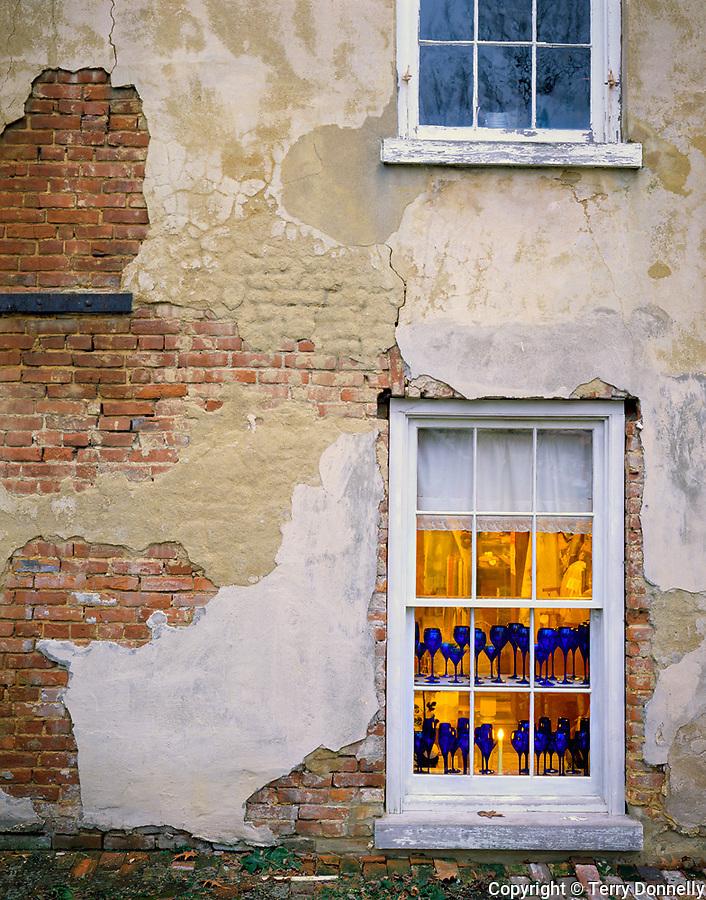 Bishop Hill, IL<br /> Blue glassware in shop window &amp; textured brick wall  Bishop Hill State Historic Site, IL