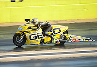 Sept. 21, 2012; Ennis, TX, USA: NHRA pro stock motorcycle rider Karen Stoffer during qualifying for the Fall Nationals at the Texas Motorplex. Mandatory Credit: Mark J. Rebilas-