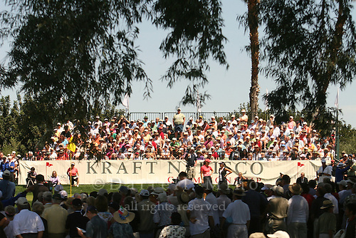 Apr. 2, 2006; Rancho Mirage, CA, USA; Michelle Wie (left) chats with Natalie Gulbis on the 9th hole during the final round of the Kraft Nabisco Championship at Mission Hills Country Club. ..Mandatory Photo Credit: Darrell Miho.Copyright © 2006 Darrell Miho .