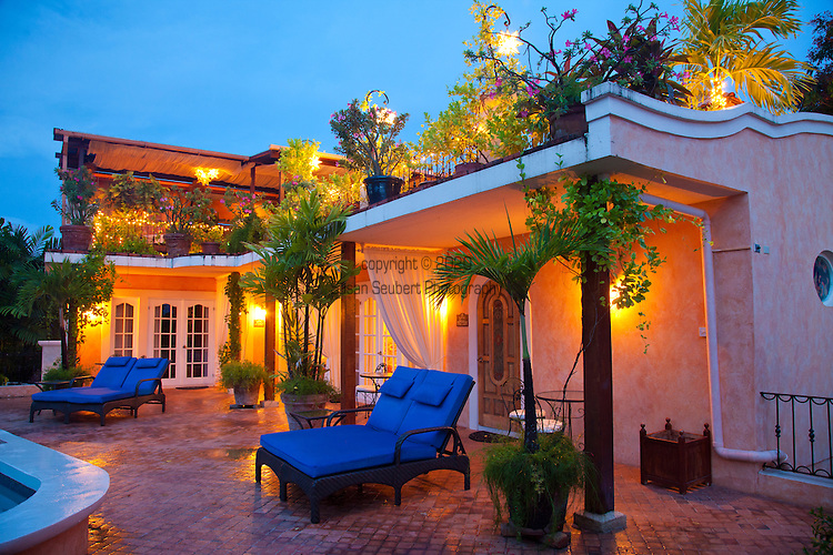 Little Arches Hotel in Oistins, Christ Church, Barbados is a lovely 10 room boutique hotel located just steps away from Enterprise Beach.  They also offer a marvelous restaurant on the roof of the property called Cafe Luna where you can dine on regional cuisine under the stars.  The pool deck area at dusk.