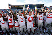 Ohio State players sing Carmen Ohio following the 42-13 win over Michigan in the NCAA football game at Michigan Stadium in Ann Arbor on Nov. 28, 2015. (Adam Cairns / The Columbus Dispatch)