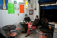 Mika and Adrian at Doña Mary's bar and lunch shop on Topacio street in the Centro. Night bicycle rides,  Mexico City.