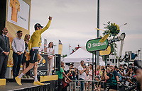 Geraint Thomas (GBR/SKY) offering his flowers to the crowd<br /> <br /> Stage 13: Bourg d'Oisans &gt; Valence (169km)<br /> <br /> 105th Tour de France 2018<br /> &copy;kramon