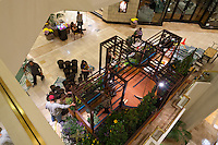 "An overview of  Orange Coast College's Ornamental Horticulture Club's in-progress installation at the 2012 South Coast Plaza Spring Garden Show in Costa Mesa, CA, seen from the second floor of the mall.  The theme for this year's show is ""healing gardens"", and the OCC team is installing a ""garden for the blind,"" which will be complete with a braille world globe and braille labels.  This picture was taken Tuesday April 25, 2012 at ~11pm, as the team was working frantically to meet their Thursday-morning deadline."