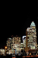 The downtown / Uptown Charlotte skyline burns bright during the night.