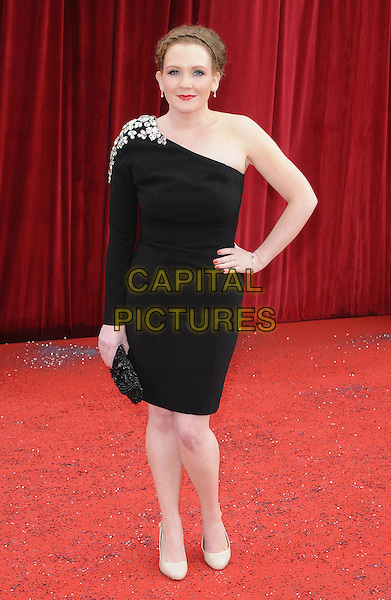 JENNIE McALPINE .At the British Soap Awards 2011, Granada TV Studios, Manchester, England, UK, MaY 14th 2011..arrivals full length one shoulder sleeve dress black hand on hip clutch bag  beaded .CAP/CAN.©Can Nguyen/Capital Pictures.