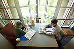 Rising seniors Nick Seal, right, and Elizabeth Jones enjoy the view and the sunlight while studying in the library.  Photo by Kevin Bain/University Communications Photography.