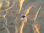 Namibia, Namib Desert, near Walvis Bay, Theo Allofs flying with a powered paraglider over sand dunes